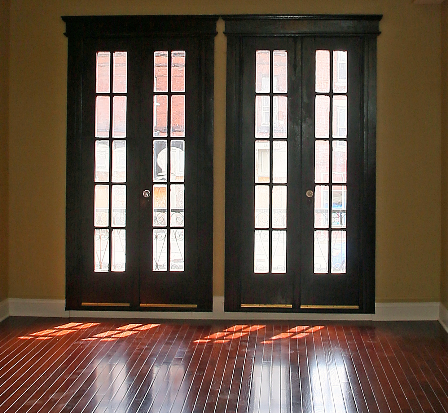French doors on the second floor bring light into the living room at 537-539 S. Salina St.