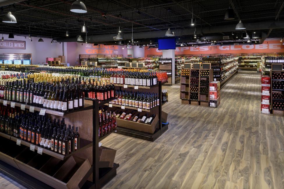 Inside of a Chittenango liquor store. Low shelves spot bottles of wine and liquor.