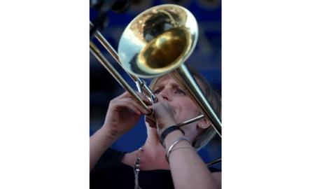 Melissa Gardiner plays trombone.